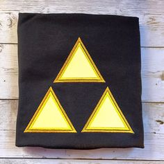 Legend of Zelda Inspired Triforce Applique Embroidery Design with Double Outline INSTANT DOWNLOAD for DIY projects, from Designed by Geeks. Use any embroidery machine - Brother, Viking, Janome, Bernina, Pfaff, Singer - to stitch this design.  This is an applique design of a Zelda triforce inspired trio of triangles with a double outline for each.