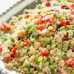 Edamame Quinoa Salad Recipe Salads with quinoa, water, salt, celery, corn, garbanzo beans, cilantro, dried cranberries, edamame, red bell pepper, sliced almonds, olive oil, lime juice, salt