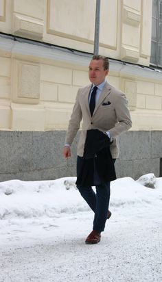 Khaki jacket, light blue shirt, navy knit tie, navy pants, navy paisley pocket square, brown double monk strap shoes