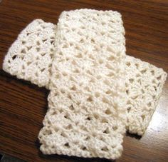Dainty and delicate, these lacy fingerless crochet gloves are nice for autumn weather.