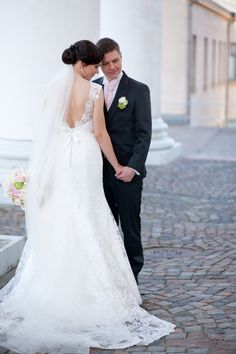 Real wedding in Finland. Dress made by Pukuni (www.pukuni.fi). Wedding dress with lace and open back. Photography / Antti Ekola Photography
