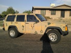 Finshed the camo on the jeep Cherokee. I am lovin it.