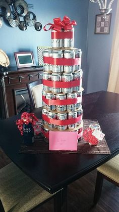 DIY Gift Ideas For Him A great valentines gift he will definitely appreciate. Cut circles out of cardboard to help stack cans of beer and wrap in red ribbon. Perfect beer tower for Valentine's Day