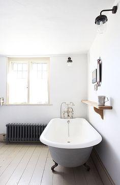 White bathroom with black lights