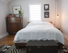 love the black and white and wood in this bedroom! A Modernized Charmer For Creatives in Pennsylvania   Design*Sponge