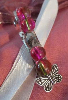 """medium hair clip; pink glass beads, silver glass bead with silver butterfly 2""""by1/2"""" product #H020 $5.00   Shop this product here: spreesy.com/yvette11168/139   Shop all of our products at http://spreesy.com/yvette11168      Pinterest selling powered by Spreesy.com"""