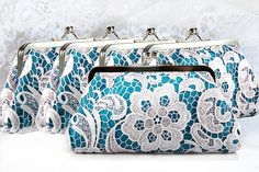 Teal and white lace clutch purses.