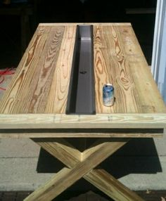 .Rustic Outdoor Table but make the center cooler bigger or drop a round bucket in the middle to fill