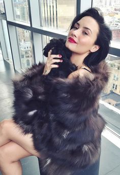 Demi Lovato Sparks Outrage While Cuddling With Her Dog in What Appears to Be a Fur Coat