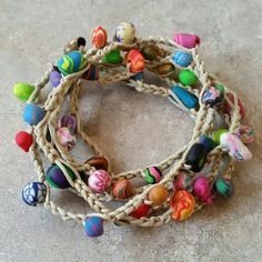 "Handmade boho style wrap bracelet. Made with a hemp cord and handmade clay beads. 43"" long. Can be worn as a bracelet, anklet or even a necklace. Maybe even a belt!"