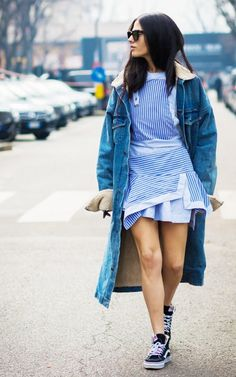 Striped asymmetrical dress, long denim shearling jacket, and Vans sneakers.