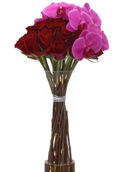 DESIGNER LUX RED ROSES AND ORCHIDS ACCENT FOR MANHATTAN DELIVERY.