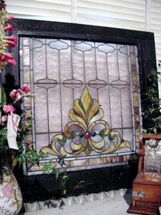 STAINED GLASS PANEL; LATE 19TH CENTURY; LEADED GLASS IN FLORAL DESIGN; GOOD CONDITION; FRAMED. on GoAntiques