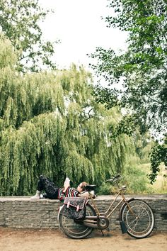 Woman Reading Beside Her Bicycle in Amsterdam | photography by http://www.kaylabeilerphotography.com/