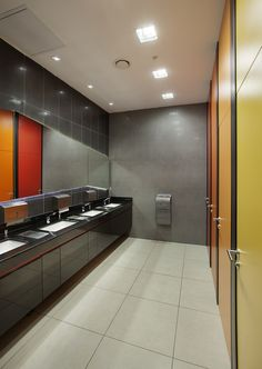 color adds spice to a monochromatic bathroom one way to keep the clean minimalist design in an office bathroom but add a splash of color is by using color bathroom office