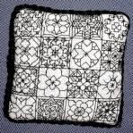 This intricate blackwork Pincushion can be stitched as individual squares suitable for Doll House pillows, or in its entirety.