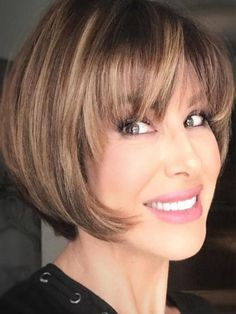 Muted Brown Short Layered Bob With Straight Bang Older women always look for elegant but not boring outdated styles. Which haircut to have and how to style it we show in these photos of classy, short hairstyles for women over Bobs For Thin Hair, Short Hair With Layers, Layered Bob With Bangs, Medium Layered Bobs, Hair Short Bobs, Short Hair With Bangs For Round Faces, Fine Thin Hair, Short Hair Cuts For Women Over 50, Short Hair Over 50