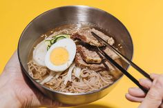 Be part of Weightlifting Fairy Kim Bok Joo's Awesome Squad and indulge in a bowl of Korean cold noodles. The last stage in their four-step meal plan, Naengmyeon consists of chewy buckwheat noodles served in a chilled beef broth. Topped with tender beef brisket slices, a hardboiled egg and pickled vegetables, this refreshing dish is ideal for eating in the summer or on hot tropical days. Korean Cold Noodles, Asian Food Channel, Kim Bok Joo, Sesame Beef, Japanese Cucumber, Fairy Food, Cambodian Food, Buckwheat Noodles, Brisket Chili
