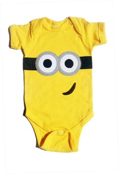 Heres another special request. This ia a Despicable Me inspired onesie! Hand drawn and hand cut felt applique on your choice of a yellow onesie
