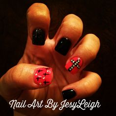 Coral and black with crosses nail art