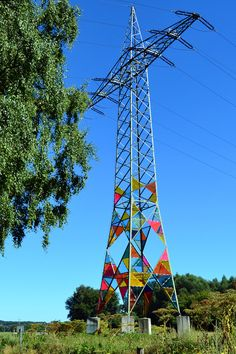 Leuchtturm (Lighthouse) by Ail Hwang, Hae-Ryan Jeong and Chung-Ki Park in Hattingen, Germany. Cut triangles of Acrylglas installed on an electrical tower to mimic the function of traditional stained glass pieces. Land Art, Plexiglass Panels, Transmission Tower, Glass Installation, Rainbow Glass, Colossal Art, Outdoor Art, Art Plastique, Public Art