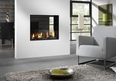 Superb Dual Aspect Fireplace Design In Grey And White Living Room With Gray Sofa Set - Use J/K to navigate to previous and next images Home Fireplace, Fireplace Design, Living Room Modern, Living Room Interior, Grey Sofa Set, Minimalist Fireplace, See Through Fireplace, White Walls, House Design