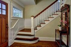 Love the front door, wide front porch, staircase to right of entry hardwood floors, pressed wood trim, bookcase dividers and all the built-ins the kitchen and even bath are great! House Design, Craftsman Staircase, House, Home, Craftsman Bungalows, Staircase Design, Craftsman Interior, Bungalow Homes, Craftsman House