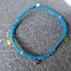 Girls necklace on blue hemp with little glass hearts and round glass beads ##completedprojects #hempjewlz #hemp #jewelry #coloredhemp #blue #glass #beads #hearts #yellow #purple #green
