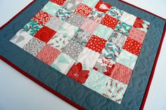 Modern Christmas Quilted Table Topper in Red and Green Prints and Floral Patchwork - Quiltsy Handmade by MyBitOfWonder on Etsy https://www.etsy.com/listing/474595782/modern-christmas-quilted-table-topper-in