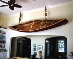 Wall mounted merrimack canoe - looks cool but you are destroying the canoe! It will warp it out if shape. Canoe Storage, Wood Canoe, Lake Decor, Lake Cabins, Loft, Wooden Boats, Looks Cool, New Homes, Canoeing