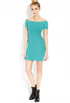 Style Deals - A stretch knit bodycon dress featuring an off-the-shoulder neckline. Cap sleeves. L...