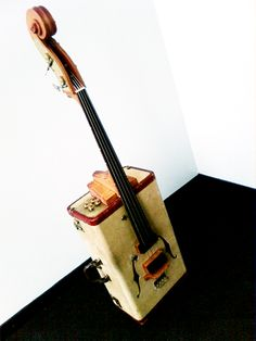 "Vintage suitcase into Upright bass in electronics art  with suitcase Music.  This must be the ""travel"" size?  LOL  I wish I had one!"