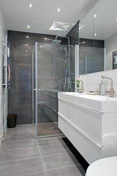 Idée décoration Salle de bain  Une salle de bains en gris et blanc | design décoration salle de bain. Plus d