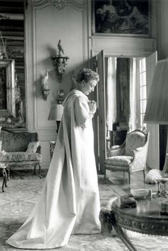 Mrs Mona von Bismarck in Balenciaga evening coat in pale blue silk satin faille, Winter 1955, in the famous Cecil Beaton photo shoot at the Hotel Lambert