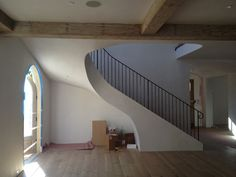 Curved stairs still under construction In a Spanish Colonial home.