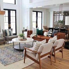 neutral meets traditional living room decor, neutral living room design with wood and upholstered armchair and fireplace decor, leather sofa in open floor plan family room design Living Room Styles, Home Living Room, Living Room Designs, Living Room Furniture, Living Room Decor, Chairs For Living Room, Casual Living Rooms, Barn Living, Furniture Layout