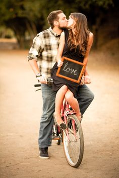 Engagement photo. Cute idea... But thinking this bike needs to be a dirt bike. .