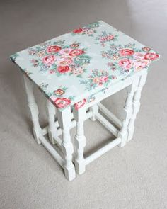 covered a set of nesting tables with oilcloth