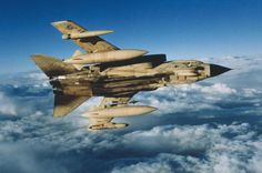 Iraq War 1991:  A Tornado GR.1 in flight banks away from the camera and displays its underwing stores which are, top to bottom, BOZ 107 chaff/flare dispenser, 500 gal fuel tanks, AIM-9 Sidewinder air-to-air missile and Marconi Sky Shadow ECM pod.