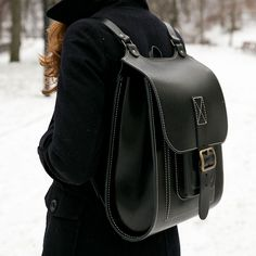 Black leather backpack with white stitching handmade