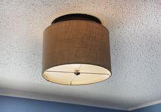 Transform a boring builder-grade, ceiling light into a pretty, flush-mount drum shade, in a few easy steps!