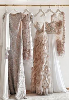 those are some magical magical fancy dresses!  I think someday when I get married, I want to wear something a little outside of the norm when it comes to pattern and styling.  But these are the colors I dream of for sure.