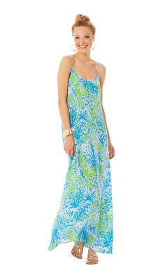 The Jaylene Maxi dress is a silk maxi dress with a scoop neckline. This         beautiful maxi dress is in one of our favorite new prints - Biggest Fan. The    blues and greens compliment all skin tones and the racer back detail is a chic  update.