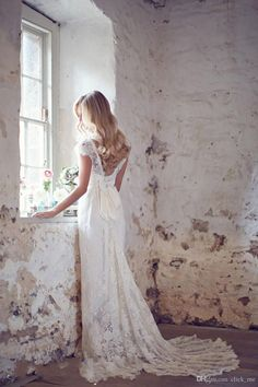 Lace overlay wedding dress with bow and pleated train for $123.58