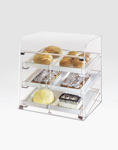 Classic Large Bakery Case   Item: 288  This large self serve bakery display case features a clear acrylic style that will not only have room for all your items but it will also complement your bakery, coffee shop, or market. With its front dual doors, this bakery display case is also ideal for self service stations at your cafeteria or hotel breakfast bar. If you are looking for a way to dress up your baked goods, you cannot go wrong with this case. It will sure attract your customers and…