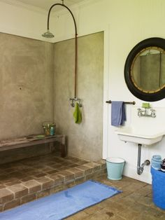 NO to showers without curtains or walls.  Who the hell wants to wipe down the tile every day?