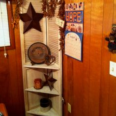 Primitive corner cabinet made out of an old closet door and some wood for shelves! Love it!