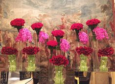 AD catches up with the star floral designer at the Four Seasons George V in Paris to watch him decorate the lobby with crimson and pink blooms