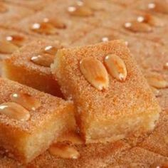 MPOWER/// Namoura - Lebanese Semolina Cake Recipe - My favorite Lebanese dessert! Arabic Dessert, Arabic Sweets, Arabic Food, Middle East Food, Middle Eastern Desserts, Lebanese Desserts, Lebanese Recipes, Lebanese Cuisine, Food Cakes