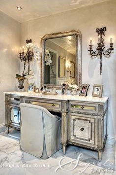 Mirrored vanity and carrarera marble